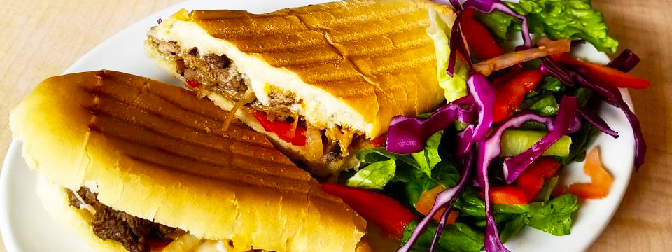 Philly Cheese Steak Sandwich with salad